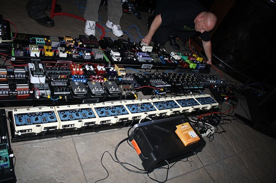 http://guitartreats.com/wp-content/uploads/2011/08/largest-guitar-pedal-board.jpg